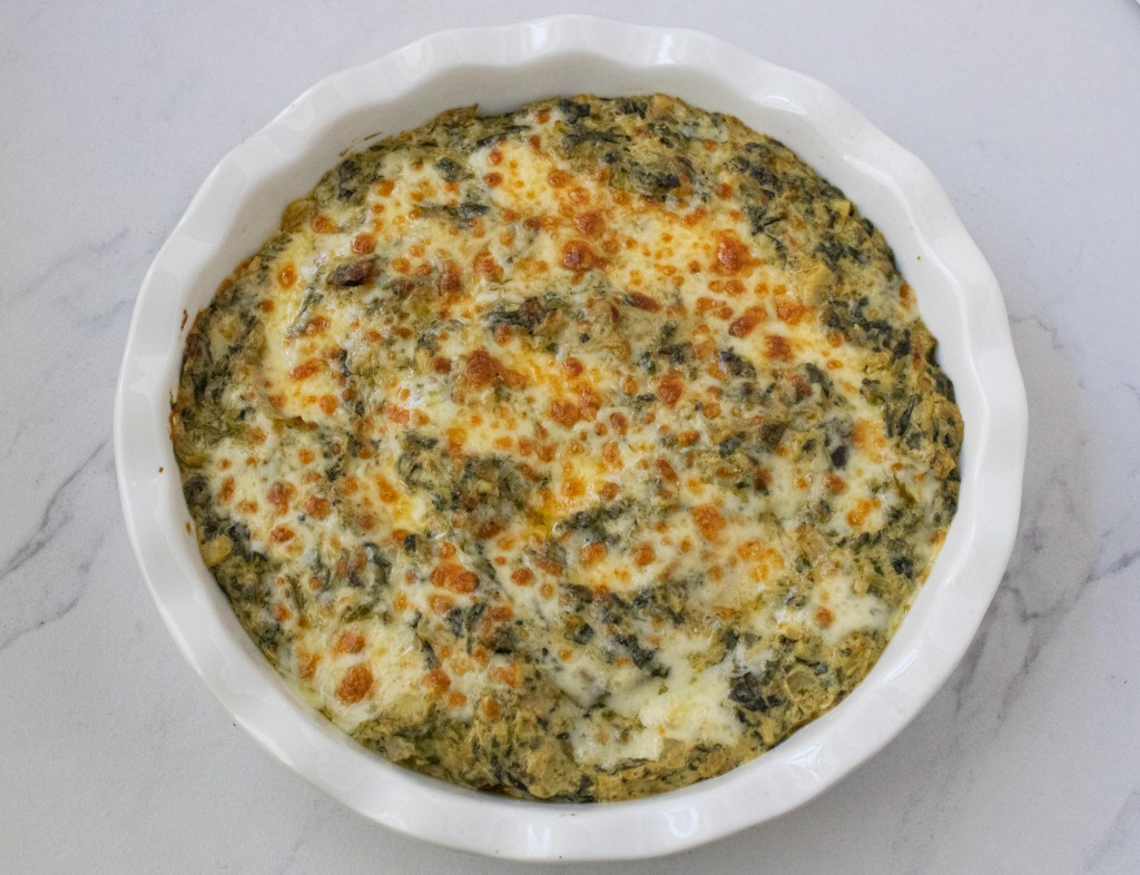 Southwest spinach artichoke dip after baking in white pie dish